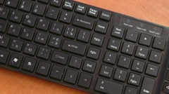 Man presses Enter-on the black keyboard - stock footage