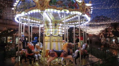 Merry Go Round in festive lights on the Christmas carnival. Stock Footage