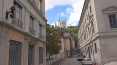 Stock Video Footage of Basilica of Notre-Dame de Fourviere, Lyon landmark, old vintage street, France