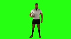 Stock Video Footage of Serious rugby player holding ball