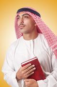 Arab man praying on white Stock Photos