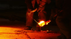 Workers working on melted iron.  Stock Footage