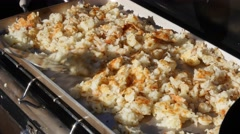 Timelapse man cooks potato hash browns while camping Stock Footage