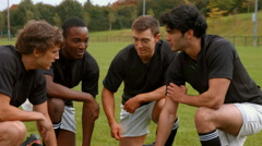 Rugby team discussing tactics Stock Footage