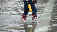 Tourists walking in the high water in Venice, Italy Stock Footage