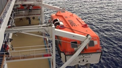 Lifeboat Being Brought Back Onboard a Cruise Ship Stock Footage