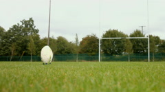 Close up of a rugby player kicking a rugby ball Stock Footage