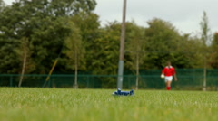 Rugby playe running with ball in hand Stock Footage