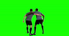 Rear view of serious rugby players playing Stock Footage