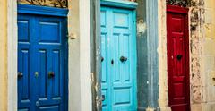 three color doors in a street of Valletta - stock photo