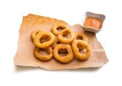 Onion rings on parchment Stock Photos