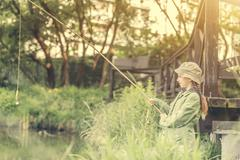 little fisher girl holding a rod - stock photo