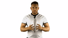 Stock Video Footage of Serious rugby player holds rugby ball