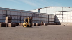 Vegetable stock. loader load boxes on tractor Stock Footage