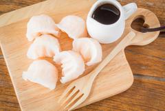 Chinese har gao dim sum dumplings on wooden plate Stock Photos