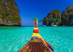 Traditional longtail boat in Maya bay on Koh Phi Phi Leh Island, Krabi, South - stock photo