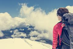 Female alpinist enjoying the view. - stock photo