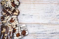 Stock Photo of Chocolate bark on wood background