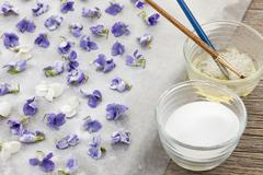 Stock Photo of Making candied violets