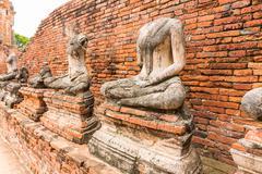 Old Buddha Statue at Wat Chaiwatthanaram Ayutthaya ,Thailand - stock photo