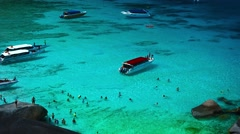 Overlooking shot of tour boats in a natural harbor at Koh Similan Stock Footage