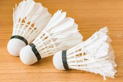 Close up White Shuttlecock on wooden background - stock photo