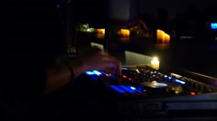 Disc Jockey Mixing Deck and Turntables at Night with Colourful Illuminated Stock Footage