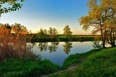 Silent summer evening by the river - stock photo