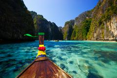 Traditional longtail boat in pile bay on Koh Phi Phi Leh Island, Krabi, South - stock photo