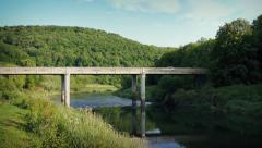 Car crosses Bridge Over River In Sunny Valley Stock Footage