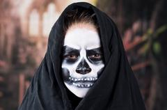 Young boy with skull make up - stock photo