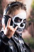 Young tough boy with skull make up Stock Photos