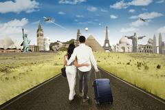 Happy couple going to honeymoon at the world monuments Stock Photos