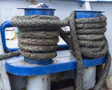 Green rope on ship bit Stock Photos