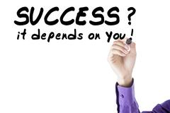 Person write success depends on you - stock photo