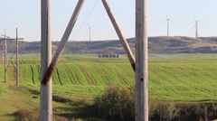 Hills in the country host turbine energy towers - stock footage
