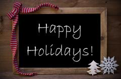 Chalkboard With Christmas Decoration Happy Holidays - stock photo