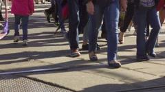 Crowd of people on street, crossing road, lower part, feet, slow motion. Stock Footage