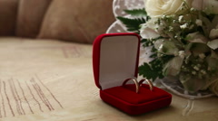 Wedding rings in  the red box in the background bridal bouquet video Stock Footage