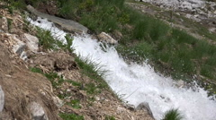 Stock Video Footage of Meltwater flowing downhill alps mountain Austria
