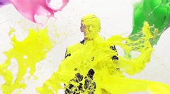 Pouring paint on a man Stock Footage