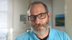 Portrait of a mature professional creative man with glasses Stock Footage