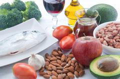 10 foods to lower cholesterol : tea , avocado , fruit , vegetables,walnuts , - stock photo