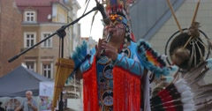 Man Playing Flute And Dancing Indians Performers in National Costumes Feathers Stock Footage