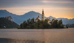 Stock Photo of Little Island with Catholic Church in Bled Lake, Slovenia at Sunrise with Cas