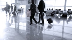 Passengers with luggage in modern Zurich-Kloten Airport Stock Footage
