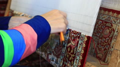 Woman working with rag on weaving-loom Stock Footage