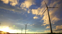 Sunset view at wind turbines under evening sun Stock Footage