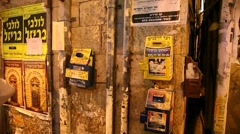 Charity cash boxes in the Ultra Orthodox Jewish community Mea Shearim Jerusalem - stock footage
