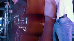 Man playing a contrabass at jazz fest, close up Stock Footage
